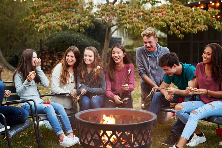 Teenagers around firepit